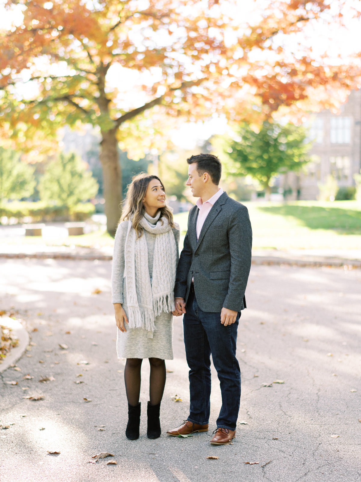 couple standing in the fall colours in hamilton