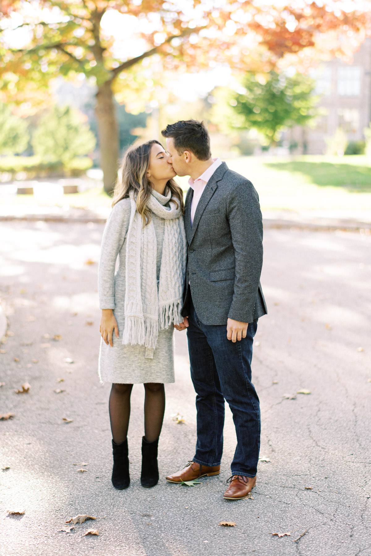 couple kissing under the fall colours in mcmaster campus