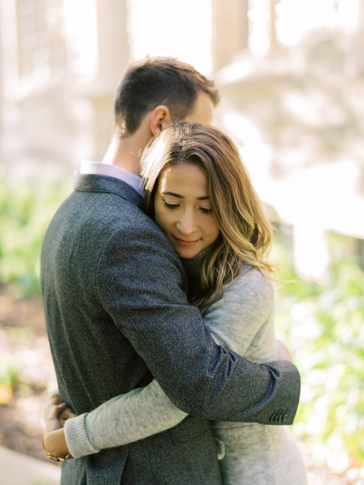 a close hug during the engagement session