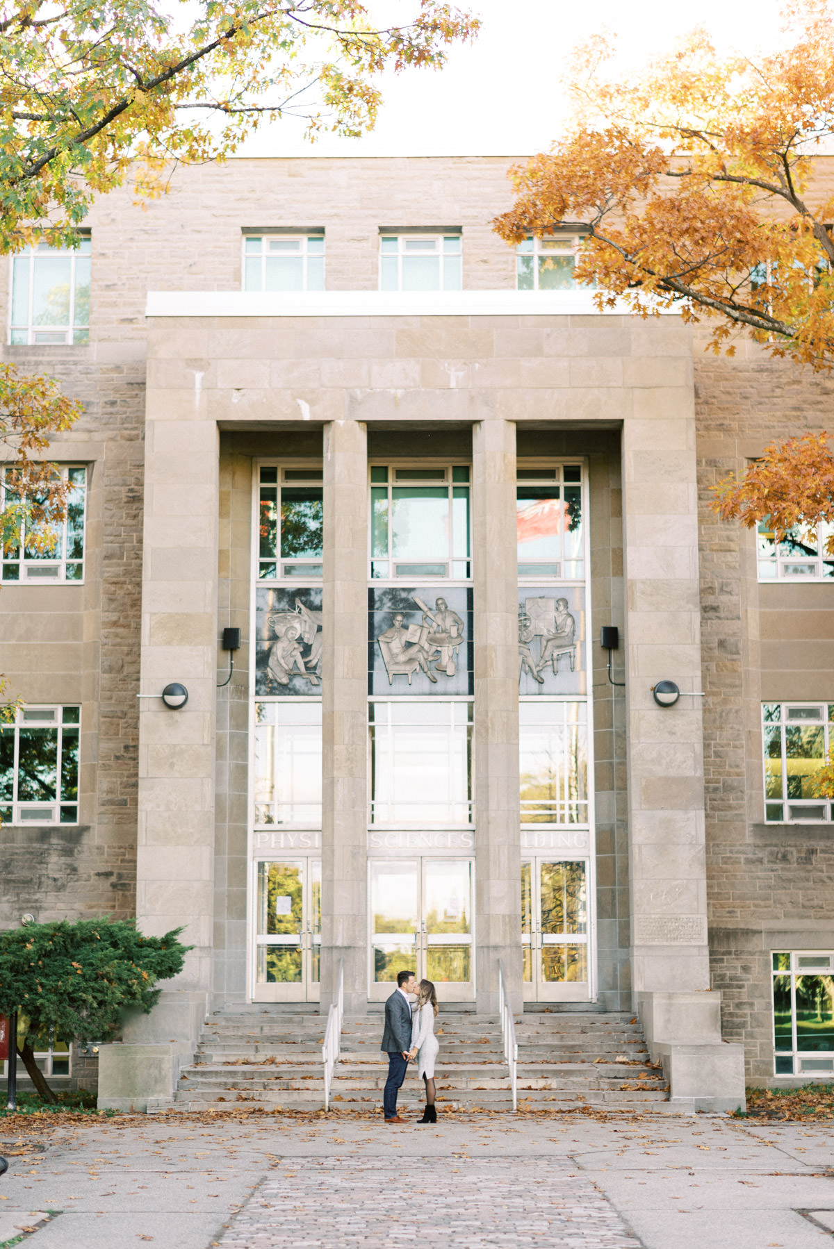 couple in front of the building at mcmaster