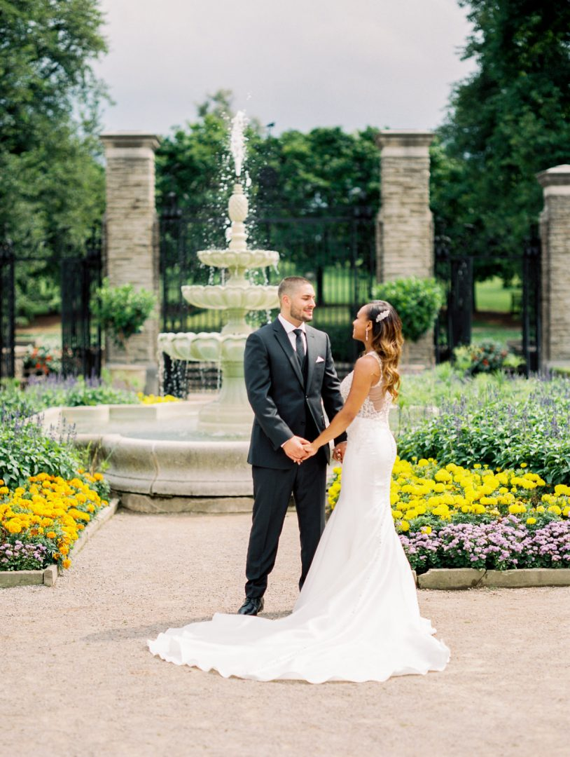 Bride & Groom in front of the fountain at the RBG