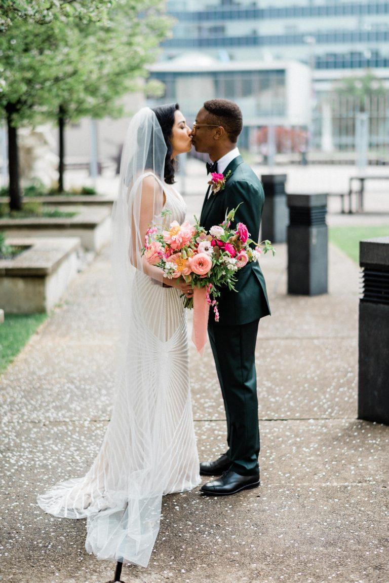 bride and groom kissing at the AGH