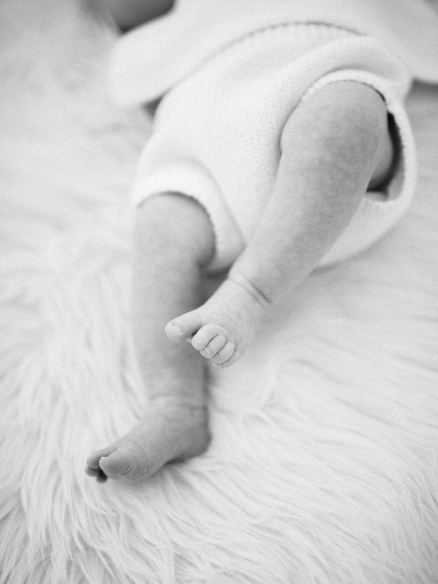 close up of baby feet, in black and white