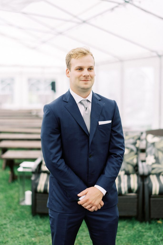 groom anxiously awaiting his bride