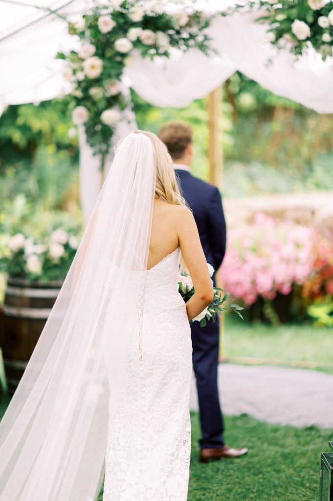 bride from behind, walking up for the first look