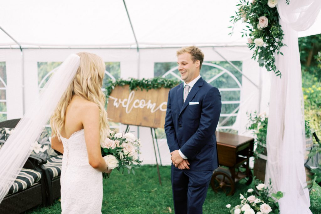 groom turning around and seeing his bride for the first time
