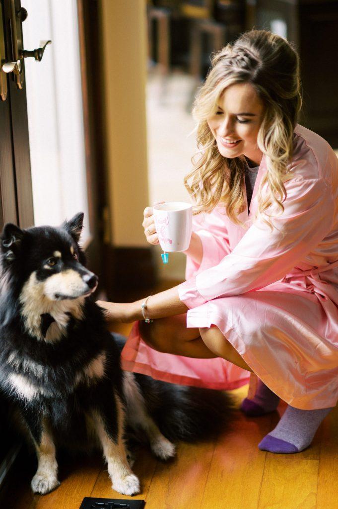 bridesmaid petting their dog