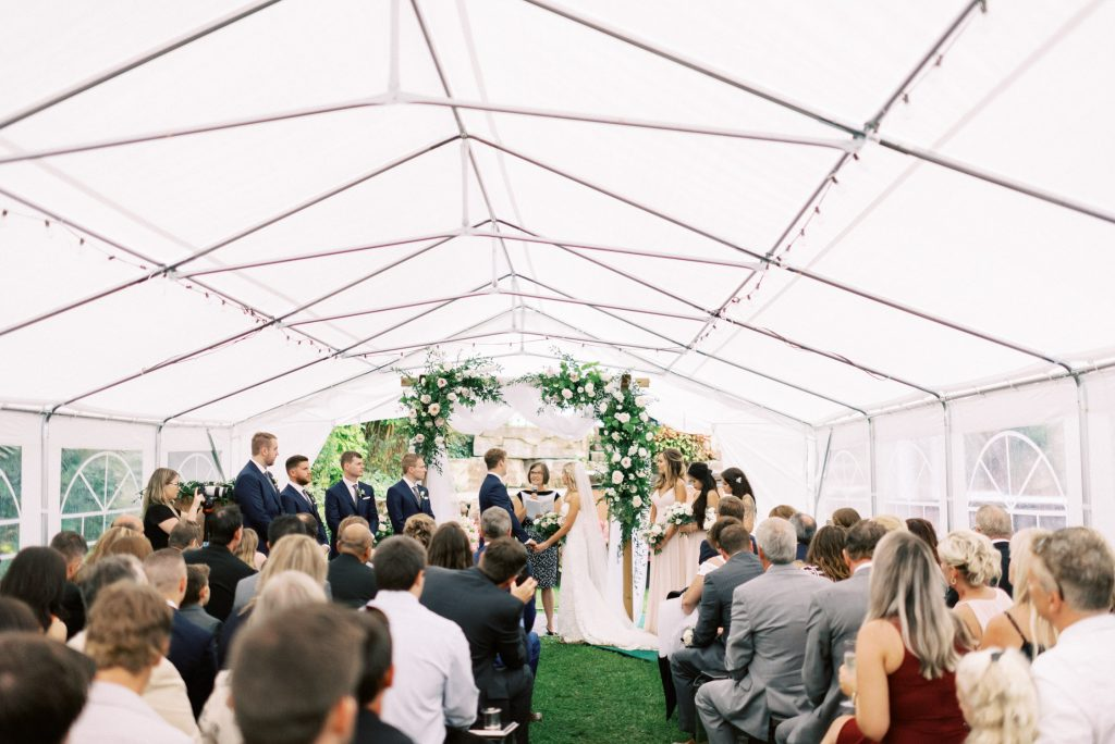 wedding ceremony inside the backyard tent