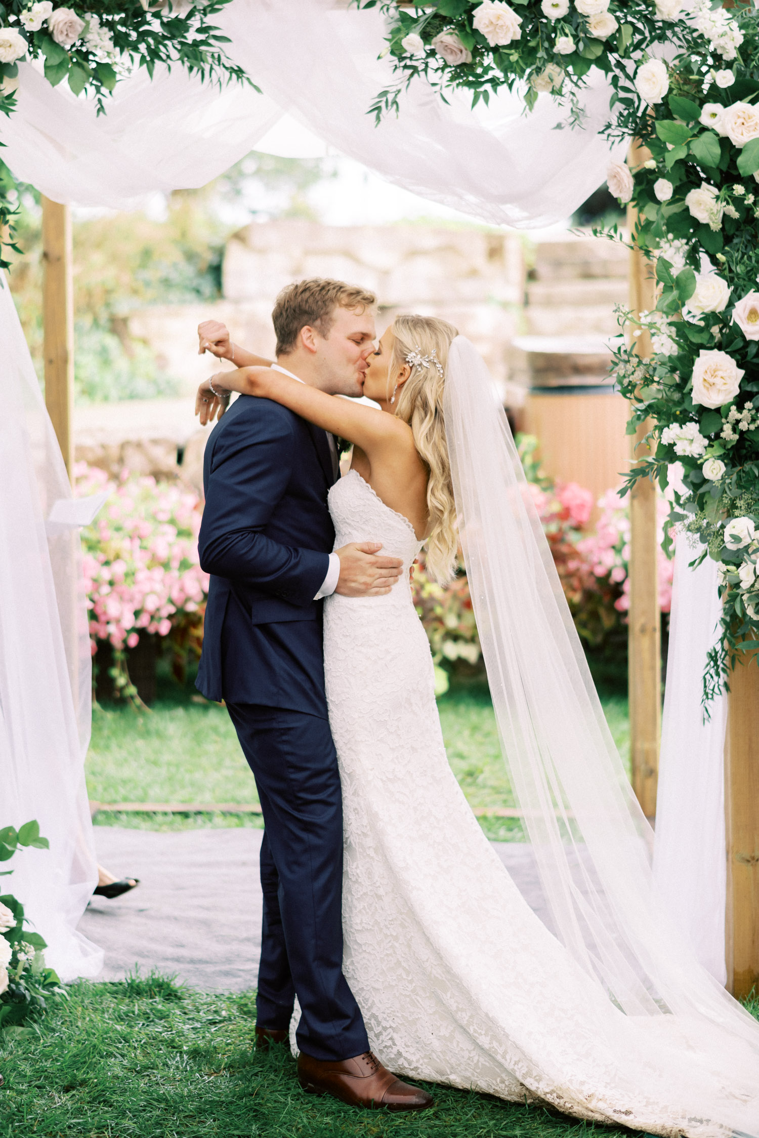 bride and grooms first kiss during the ceremony