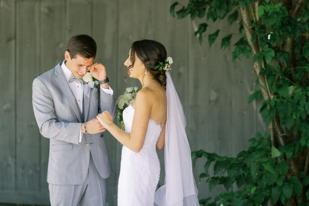 groom wiping away a tear