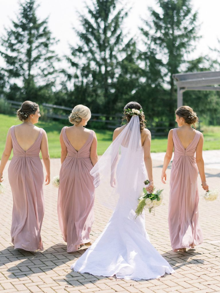 bride and bridesmaids walking away