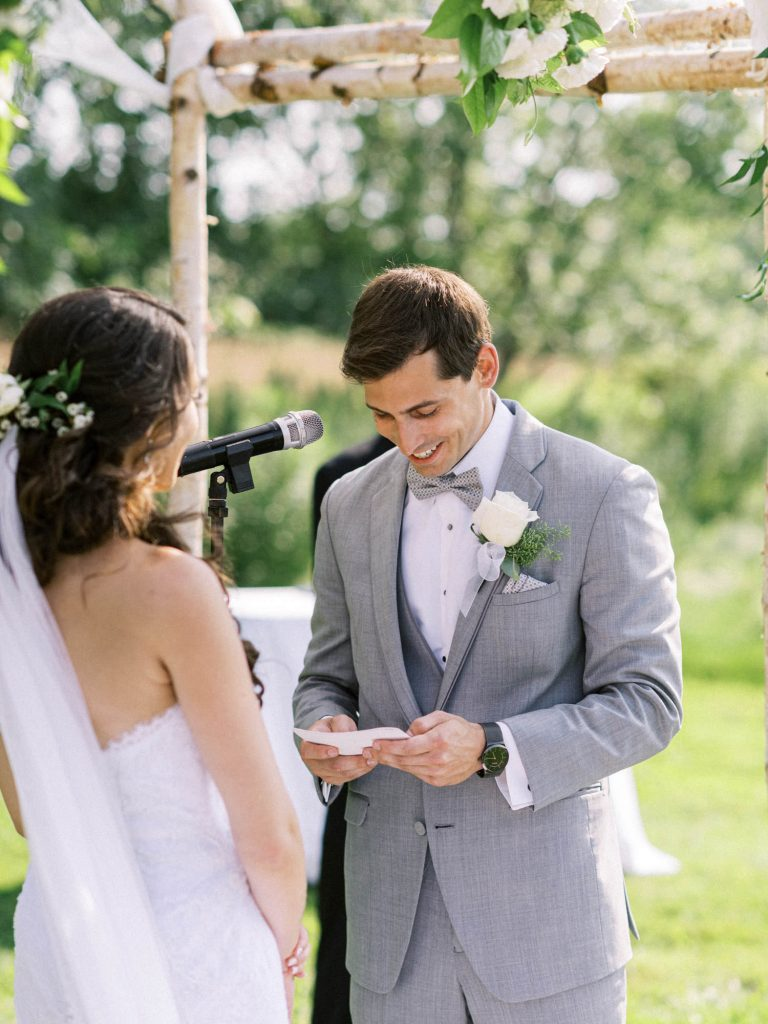 groom reading his vows at bellamere