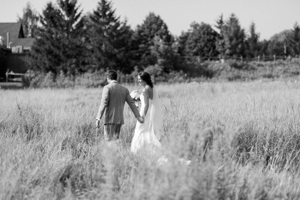 bride and groom recessional through the field at bellamere