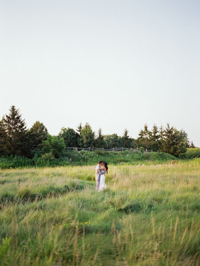 kissing in the field at bellamere at sunset