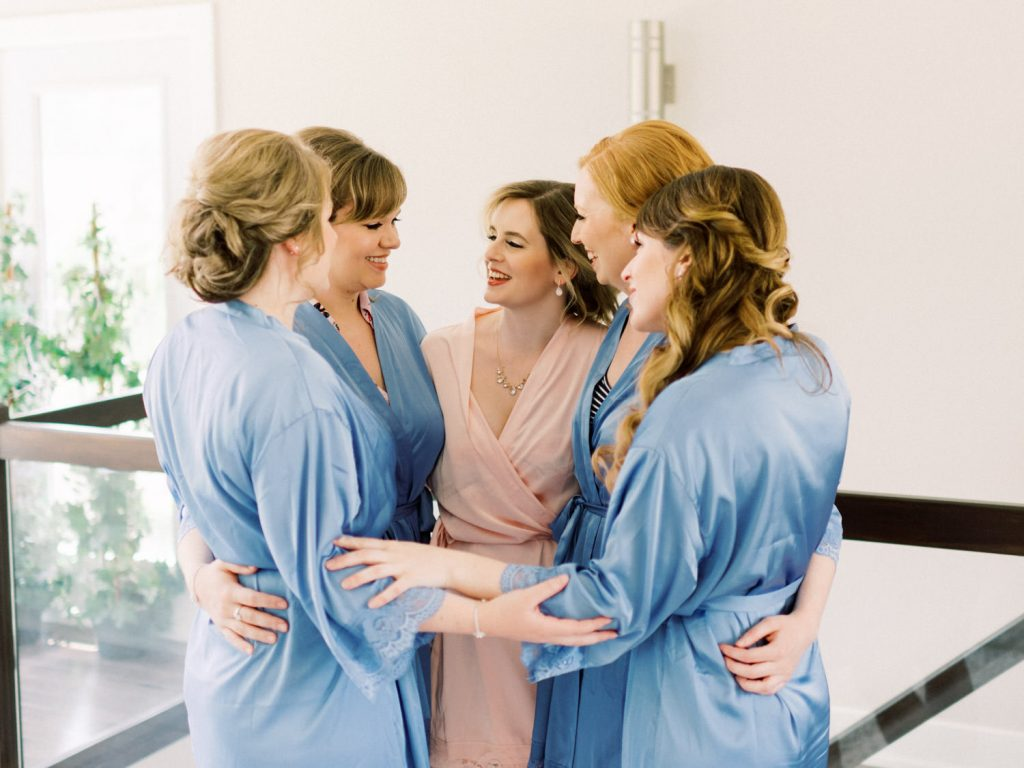 bridal party embracing