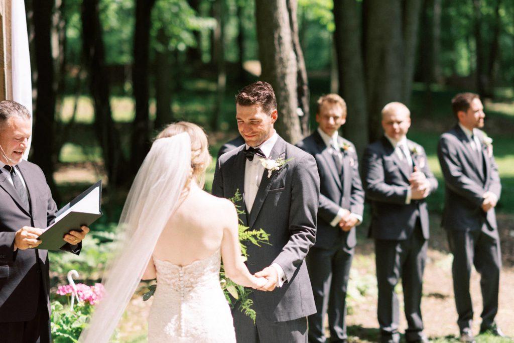 bride and groom holding hands in fernwood hills
