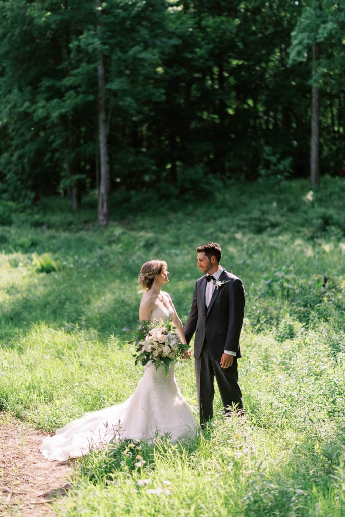 bride and groom portrait in a clearing in the forest