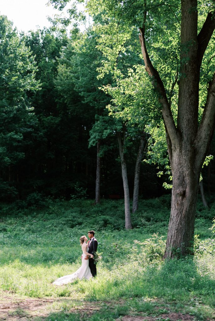dramatic portrait of bride and groom in the forest in fernwood hills