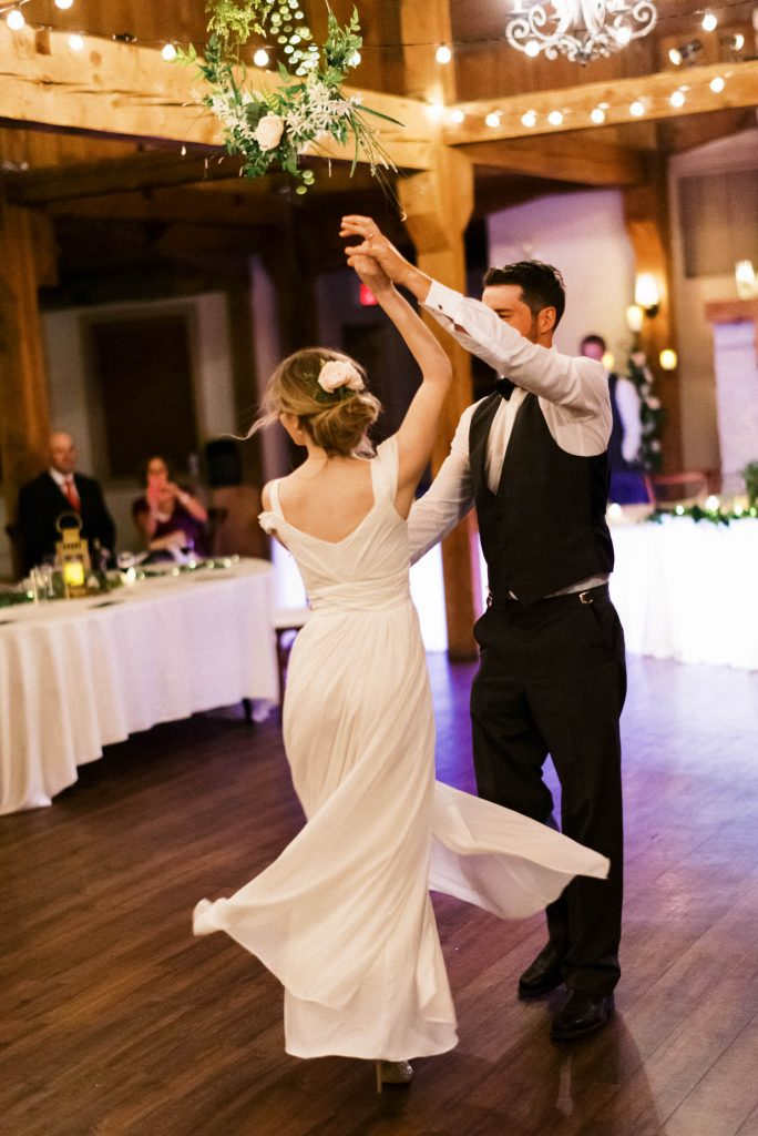 bride and groom first dance at bellamere spinning